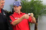 Padraig Harrington demonstrates how to mark and lift your ball correctly on a green during an entertaining golf clinic on Day 3 Saturday of the Abu Dhabi HSBC Golf Championship, 22nd January 2011..(Picture Eoin Clarke/www.golffile.ie)