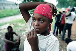 KINSHASA, DEMOCRATIC REPUBLIC OF CONGO - APRIL 29: Francine Nganda, age 14, looks for her friends on April 29, 2006 in Matonge district in central Kinshasa, Congo, DRC. Francine is homeless and works as a prostitute with four friends. They live outside, next to a polluted river. She has run away from here family. She has from time to time been living in a homeless shelter for children, but doesn't like the rules there. She usually smokes cigarettes, marijuana, drinks whiskey and sometimes takes Valium. She charges the clients as little as US$ 1. About 15,000 children are estimated to live on the streets of Kinshasa. Congo, DRC is in ruins after forty years of mismanagement by the corrupt dictator and former president Mobuto Sese Seko. He fled the country in 1997 and a civil war started. The country is planning to hold general elections by July 2006, the first democratic elections in forty years.(Photo by Per-Anders Pettersson)