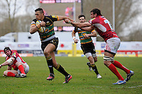 Luther Burrell of Northampton Saints escapes the clutches of Julio Cabello Farias of London Welsh during the Aviva Premiership match between London Welsh and Northampton Saints at the Kassam Stadium on Sunday 14th April 2013 (Photo by Rob Munro)