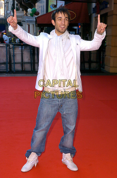 "SEZER YURTSEVEN.The ""Just My Luck"" UK premiere at Vue West End, London, UK..June 28th, 2006.Ref: CAN.full length jeans denim white jacket fingers.www.capitalpictures.com.sales@capitalpictures.com.©Capital Pictures"