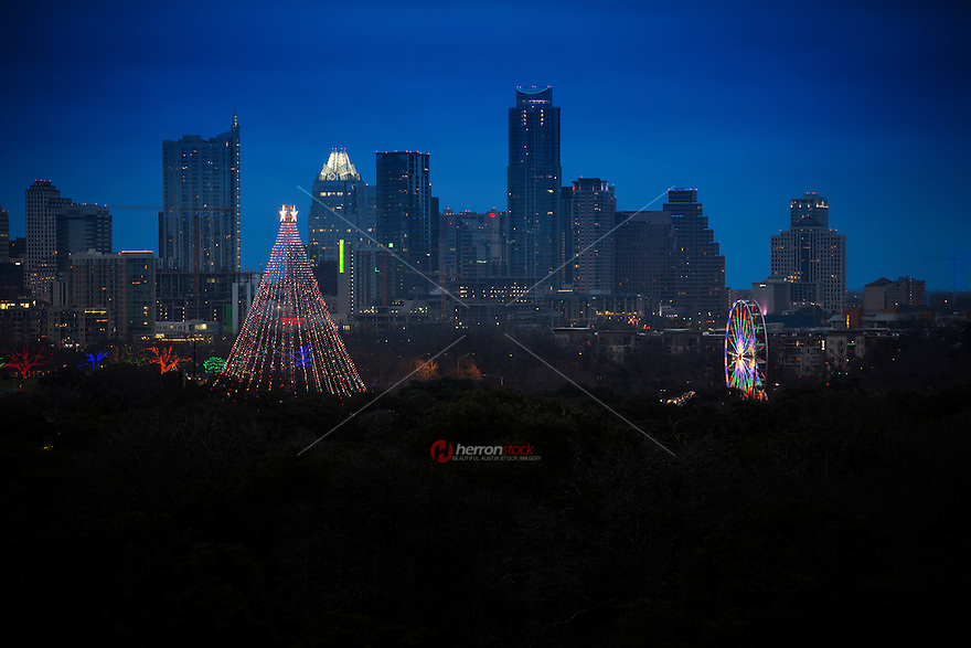To celebrate the 50 year anniversary of the Austin Trail of Lights a colorful neon Ferris wheel has been erected next to the Zilker Holiday Tree as an added attraction.