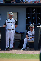 UCF Knights assistant coach Nick Otte (41) and head coach Greg Lovelady (23) in the dugout during a game against the Siena Saints on February 17, 2019 at John Euliano Park in Orlando, Florida.  UCF defeated Siena 7-1.  (Mike Janes/Four Seam Images)