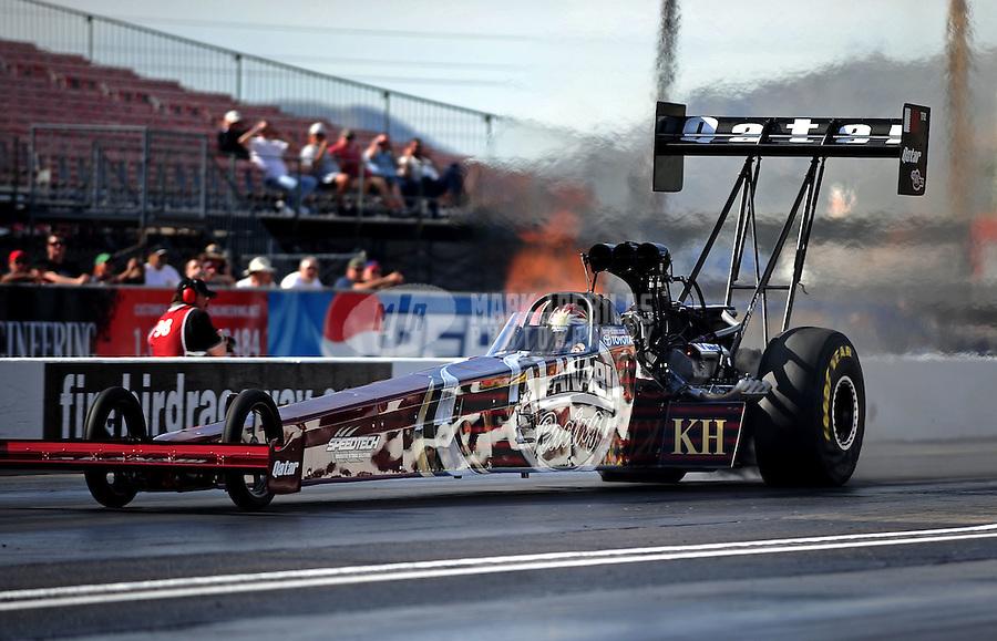 Feb. 19, 2010; Chandler, AZ, USA; NHRA top fuel dragster driver Larry Dixon during qualifying for the Arizona Nationals at Firebird International Raceway. Mandatory Credit: Mark J. Rebilas-