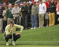28 SEP 12  Ian Poulter lines up a putt during Fridays foresome matches  at The 39th Ryder Cup at The Medinah Country Club in Medinah, Illinois.