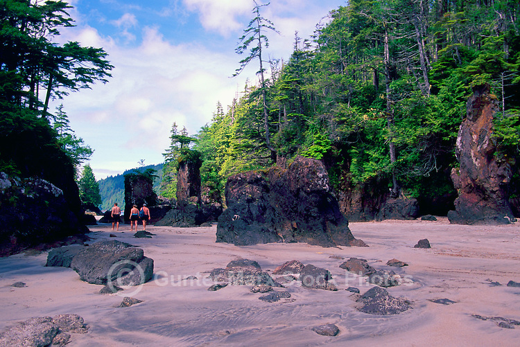 Cape Scott Provincial Park, Northern Vancouver Island, BC, British Columbia, Canada - Hikers hiking on Rugged Beach at San Josef Bay