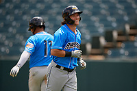 Akron RubberDucks Connor Marabell (16) smiles as he jogs back to the dugout after hitting a home run during an Eastern League game against the Bowie Baysox on May 30, 2019 at Prince George's Stadium in Bowie, Maryland.  Akron defeated Bowie 9-5.  (Mike Janes/Four Seam Images)