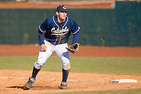 First baseman Brett Huffman #41 of the Catawba Indians on defense versus the Shippensburg Red Raiders on February 14, 2010 in Salisbury, North Carolina.  Photo by Brian Westerholt / Four Seam Images