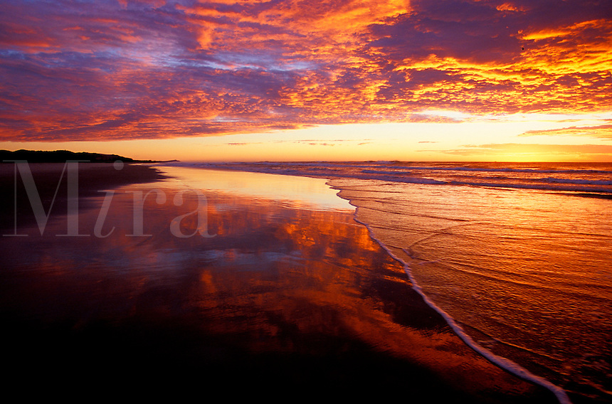 Australia, Queensland, Moreton Island, sunrise reflections on beach<br />