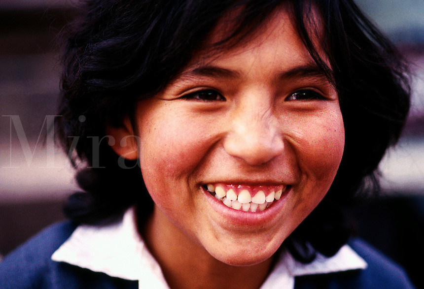 Close up portrait of a smiling teen girl in Peru.