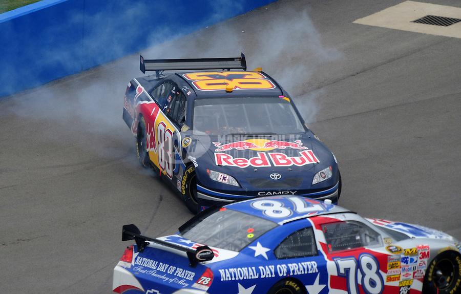 Apr 27, 2008; Talladega, AL, USA; NASCAR Sprint Cup Series driver Brian Vickers (83) spins on pit road during the Aarons 499 at Talladega Superspeedway. Mandatory Credit: Mark J. Rebilas-