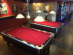 WALLY BAUMAN PHOTOGRAPHY.  Red pool tables.