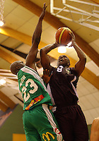 Heat guard Kavossy Franklin puts a shot up under pressure from Richard Jeter during the NBL match between Manawatu Jets and Harbour Heat at Arena Manawatu, Palmerston North, New Zealand on Saturday 17 April 2010. Photo: Dave Lintott / lintottphoto.co.nz