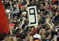 Fans of D.C. United raise Charlie Davies's number during the opening match of the 2011 season against the Columbus Crew at RFK Stadium, in Washington D.C. on March 19 2011.D.C. United won 3-1.
