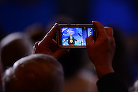National Harbor, MD - February 24, 2017: A man takes a picture of U.S. President Donald Trump as he addresses attendees of the Conservative Political Action Conference at the Gaylord Hotel in National Harbor, MD, February 24, 2017.  (Photo by Don Baxter/Media Images International)
