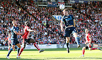 Bristol Rovers' Tony Craig heads clear under pressure from Lincoln City's John Akinde<br /> <br /> Photographer Rich Linley/CameraSport<br /> <br /> The EFL Sky Bet League One - Lincoln City v Bristol Rovers - Saturday September 14th 2019 - Sincil Bank - Lincoln<br /> <br /> World Copyright © 2019 CameraSport. All rights reserved. 43 Linden Ave. Countesthorpe. Leicester. England. LE8 5PG - Tel: +44 (0) 116 277 4147 - admin@camerasport.com - www.camerasport.com