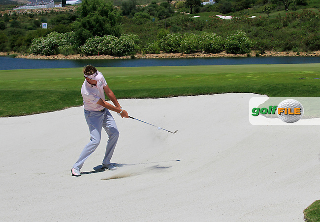 Ian Poulter (ENG) plays out of a bunker at the 3rd green during the afternoon Final session on the Final Day of the Volvo World Match Play Championship in Finca Cortesin, Casares, Spain, 22nd May 2011. (Photo Eoin Clarke/Golffile 2011)