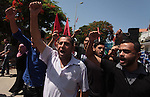 Palestinian supporters of Democratic Front for the Liberation of Palestine shout slogans during a rally to show solidarity with Palestinian prisoners held in Israeli jails, in Gaza City on June 17, 2014. Some 285 Palestinian prisoners are observing a mass hunger strike in protest against their being held without charge under a procedure called administrative detention. Of that number, 125 have been refusing food for more than six weeks, with 65 of them being treated in hospital, according to the Israeli Prisons Service. Photo by Ashraf Amra