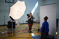 NWA Democrat-Gazette/Charlie Kaijo Robin Rankin from Life Touch photo studio prepares to take a picture of Neydi Gonzalez, 14, of Springdale on Monday, October 9, 2017 at George Junior High School in Springdale. They held their picture day on Monday
