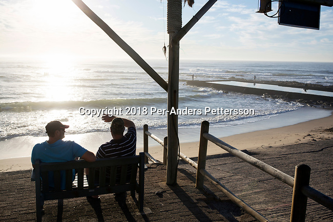 SHELLY BEACH, SOUTH AFRICA APRIL 25: Men look at the ocean an early morning on April 25, 2018 Shelly Beach in KwaZulu Natal, South Africa. The area is one of the best in South Africa for shark encounters, and a popular holiday resort for South Africans. (Photo by: Per-Anders Pettersson/Getty Images)