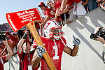 Wisconsin Badgers wide receiver Nick Toon (1) carries the Paul Bunyan Axe off the field after defeating the Minnesota Golden Gophers after an NCAA college football game on October 9, 2010 at Camp Randall Stadium in Madison, Wisconsin. The Badgers beat the Golden Gophers 41-23. (Photo by David Stluka)
