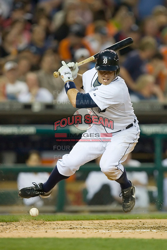 Brandon Inge #15 of the Detroit Tigers tries to avoid being hit by a pitch at Comerica Park April 27, 2009 in Detroit, Michigan.  Photo by Brian Westerholt / Four Seam Images