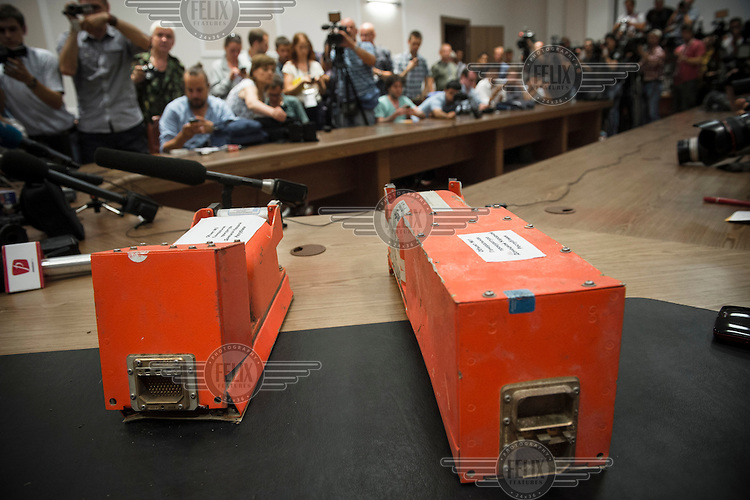 The black boxes of flight MH17 that were eventually handed over by separatists in Ukraine's Donetsk to a representative of the Malaysian National Security Council. The Malaysian Airlines flight came down in rebel held territory in Eastern Ukraine's Donetsk region on 17 July 2014. It is suspected that a surface to air missile was fired from rebel held positions which brought the plane down. In a long speech Borodai claimed that the separatists didn't have anything to do with downing flight MH17.
