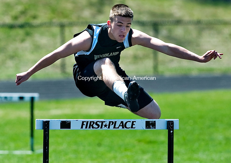 BEACON FALLS--15 April 2008--041508TJ03 - Brandon Fowler, of Woodland, clears a hurdle on his way to first place in the 300 meter hurdles during an NVL track meet at Woodland Regional High School on Tuesday, April 15, 2008. (T.J. Kirkpatrick/Republican-American)