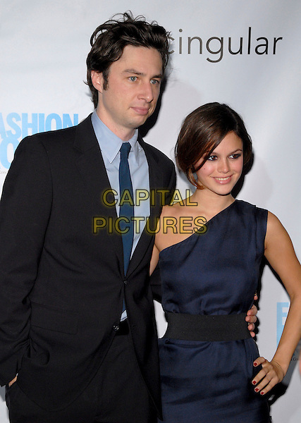ZACH BRAFF & RACHEL BILSON.Conde Nast Media Group's Third Annual Fashion Rocks Concert at Radio City Music Hall, New York, NY, USA,.7 September 2006..half length zack arm around waist navy blue one shoulder dress black waistband.Ref: ADM/PH.www.capitalpictures.com.sales@capitalpictures.com.©Paul Hawthorne/AdMedia/Capital Pictures. *** Local Caption ***
