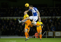 Matthew Bloomfield of Wycombe Wanderers & Lee Mansell of Bristol Rovers go up for the ball during the Sky Bet League 2 rearranged match between Bristol Rovers and Wycombe Wanderers at the Memorial Stadium, Bristol, England on 1 December 2015. Photo by Andy Rowland.