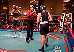 February 3, 2012:   Nevada boxer Alex Flangas, right, receives a warning from referee Vick Drakulich during his bout against Cal boxer Robert Watts in the 175 pound weight class match held at the Eldorado Convention Center on Friday night in Reno, Nevada.