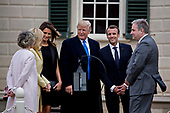 Doug Bradburn, president and chief executive officer of George Washington's Mount Vernon, from right, Emmanuel Macron, France's president, U.S. President Donald Trump, U.S. First Lady Melania Trump, Brigitte Macron, France's first lady, and Sarah Miller Coulson, regent with the Mount Vernon Ladies Association, tour outside the Mansion at the Mount Vernon estate of first U.S. President George Washington in Mount Vernon, Virginia, U.S., on Monday, April 23, 2018. As Macron arrives for the first state visit of Trump's presidency, the U.S. leader is threatening to upend the global trading system with tariffs on China, maybe Europe too. <br /> Credit: Andrew Harrer / Pool via CNP<br /> Credit: Andrew Harrer / Pool via CNP