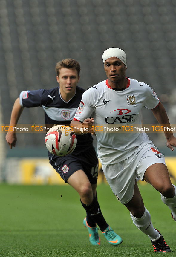 Mathias Doumbe of MK Dons and Luke Freeman of Stevenage - MK Dons vs Stevenage - NPower League One Football at Stadium MK, Milton Keynes - 20/10/2012 - MANDATORY CREDIT: Martin Dalton/TGSPHOTO - Self billing applies where appropriate - 0845 094 6026 - contact@tgsphoto.co.uk - NO UNPAID USE.