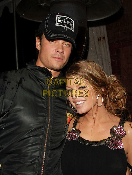 JOSH DUHAMEL & FERGIE.Fergie's Birthday Party at Citizen Smith Nightclub in Hollywood , California, USA..March 28th, 2006.Ref: DVS.Stacey Ferguson Black Eyed Peas  headshot portrait baseball cap hat couple.www.capitalpictures.com.sales@capitalpictures.com.Supplied By Capital PIctures.