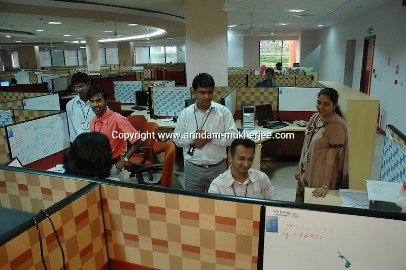 software company office. indian software professionals during work at infosys bangalore is the largest company office e
