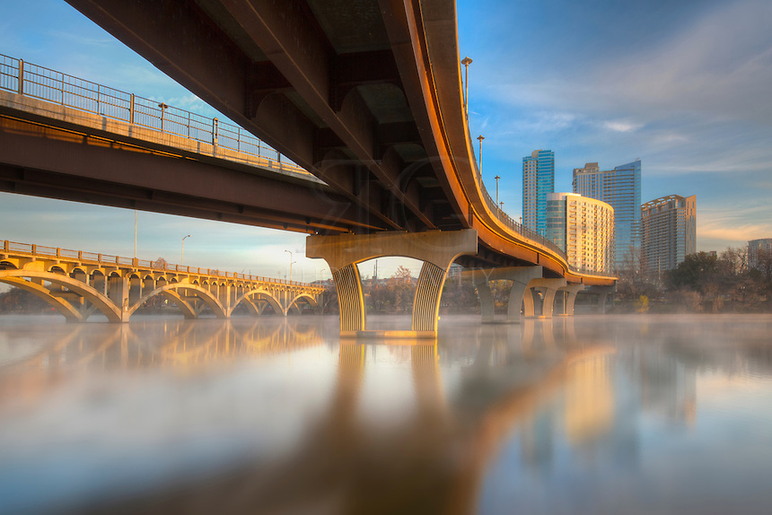 After sunrise in downtown Austin, Texas, the skies began turning blue, steam came off the waters of Lady Bird Lake, and I enjoyed the architecture of the Pedestrian Bridge that connects the city with Zilker Park.