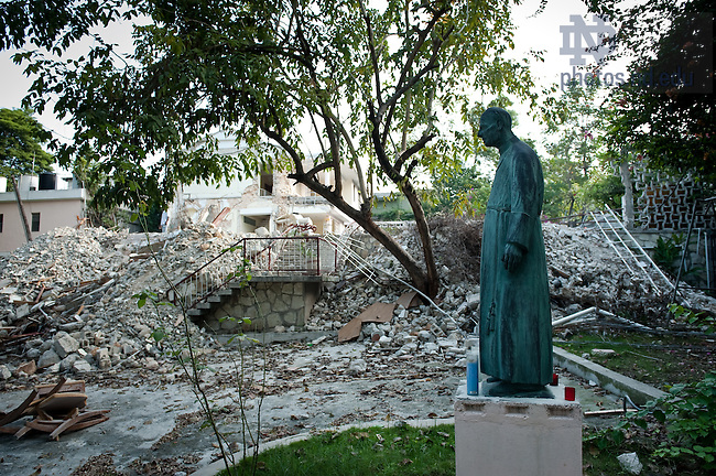 A statue of Blessed Basil Moreau, C.S.C. stands in front of the Congregation of Holy Cross provincial house in Port-Au-Prince, Haiti which was heavily damaged in the January, 2010 earthquake...Photo by Matt Cashore/University of Notre Dame