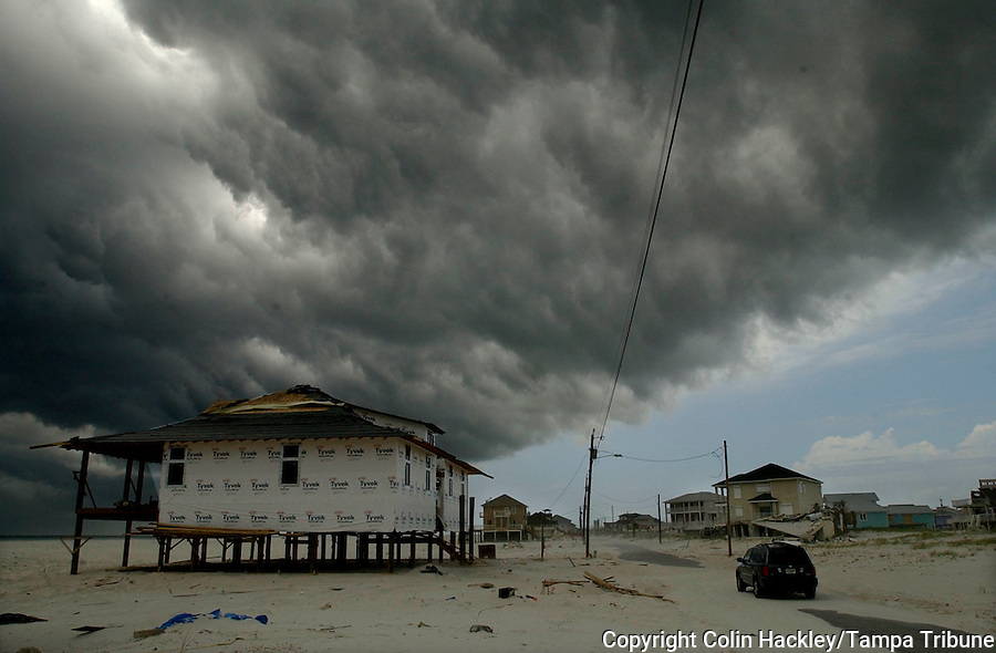 PENSACOLA BEACH, FL. 7/9/05-A dark band of clouds wipes out the blue sky Saturday as Hurricane Dennis approaches Pensacola Beach. COLIN HACKLEY PHOTO