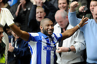 Derby v Sheffield Wednesday ... Ex-Wednesday Player Reda Johnson celebrates with fans on the terraces