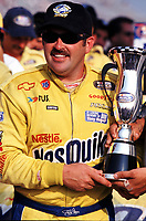 Jeff Green poses with his trophy after winning the NASCAR Busch Series race at Rockingham, NC in October 2000. (Photo by Brian Cleary)