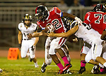 Inglewood, CA 10/09/14 - Christian Williams (Morningside #22) and unidentified Peninsula player(s) in action during the Palos Verdes Peninsula vs Morningside CIF Varsity football game at Coleman Field in Inglewood.  Peninsula defeated Morningside 24-13.