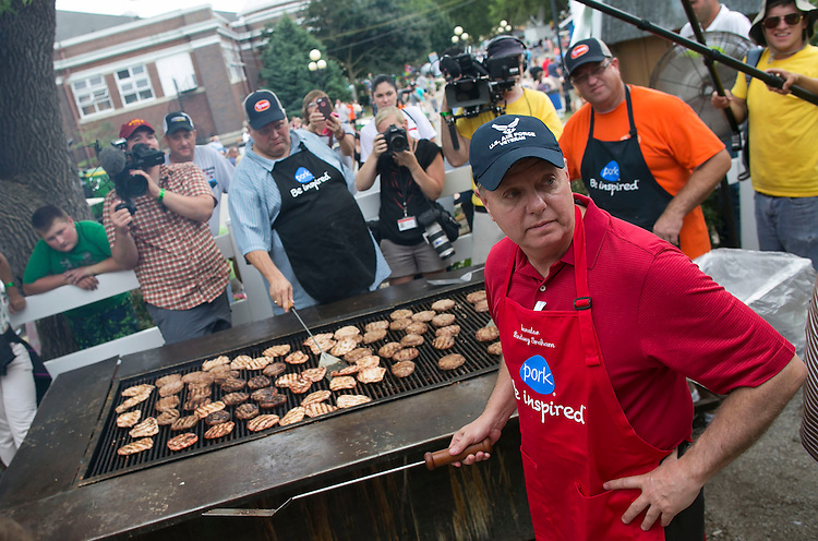 UNITED STATES - August 17: Republican presidential candidate Sen. Lindsey Graham, R-S.C., looks back as he oversees the pork chops at the Iowa Pork Producers Association site at the Iowa State Fair in Des Moines, Iowa, Monday, August 17, 2015. (Photo By Al Drago/CQ Roll Call)