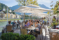 Austria, Upper Austria, Salzkammergut, Bad Ischl: Café Zauner, riverside Café-Terrace at Esplanade avenue in the centre of town | Oesterreich, Oberoesterreich, Salzkammergut, Bad Ischl: Café Zauner - Café-Terrasse an der Esplanade im Zentrum mit Blick auf die Traun