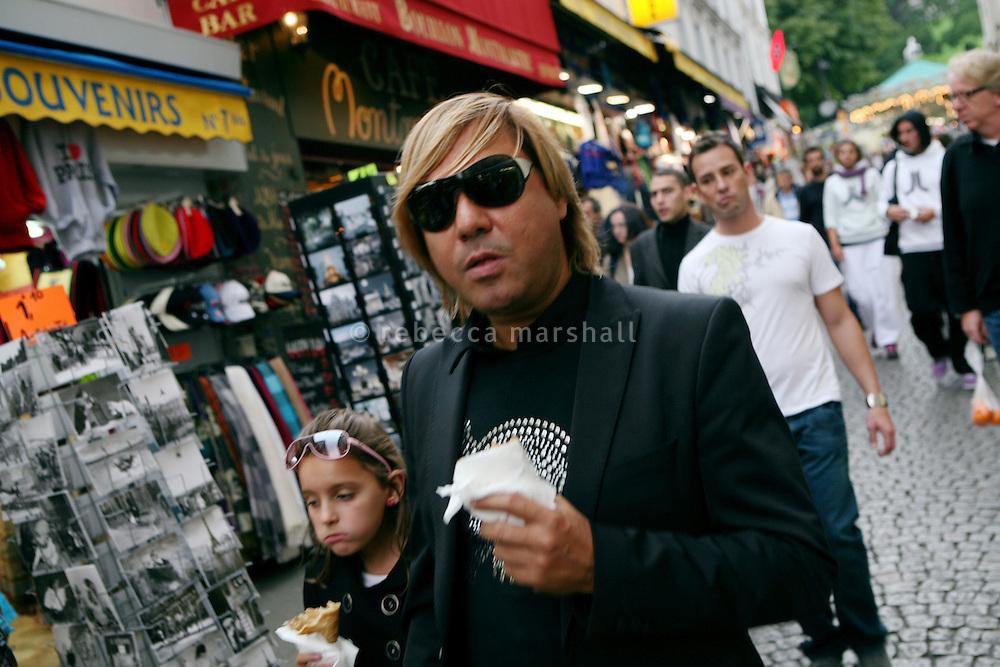 Pedestrians in La Rue de Steinkerque, Montmartre, Paris, France, 17 September 2009. <br /> A short distance from the Sacré-Coeur, souvenir shops abound.
