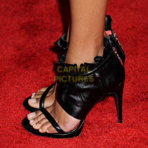 "ZOE SALDANA's shoes .""The Losers"" Los Angeles Premiere held at Grauman's Chinese Theatre, Hollywood, California, USA, .20th April 2010..detail feet black ankle boots booties sandals open toe heels .CAP/ADM/BP.©Byron Purvis/AdMedia/Capital Pictures."