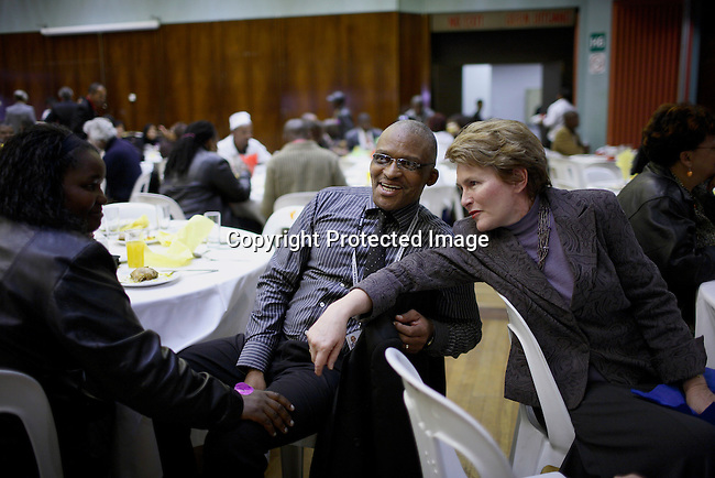 Helen Zille, the major of Cape Town talks to a colleague during lunch break at City Hall, Cape Town. .Photo by: Per-Anders Pettersson/Getty Images for Smithsonian.