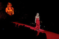 2/13/09 - Photo by John Cheng.  Olympic Swimmer Amanda Beard walks down the runway at the Red Dress Collection Fashion Show in Bryant Park, New York.  February is National Heart Month, and the fashion show is part of the month-long activities to raise women?s heart disease awareness.