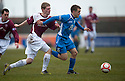 Queen of the South's Daniel Carmichael  gets away from Arbroath's Colin Hamilton.