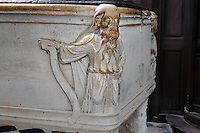 Stone for washing the dead with figure holding a scroll sculpted in the corner, late 12th century, in the North transept of the Basilique Cathedrale Notre-Dame d'Amiens or Cathedral Basilica of Our Lady of Amiens, built 1220-70 in Gothic style, Amiens, Picardy, France. Amiens Cathedral was listed as a UNESCO World Heritage Site in 1981. Picture by Manuel Cohen