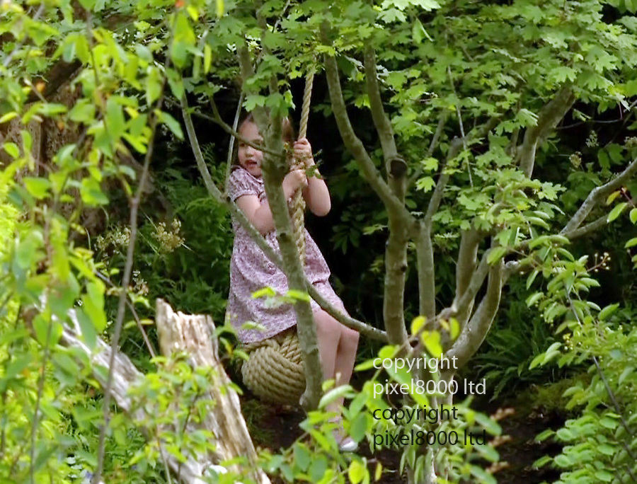 Kensington Palace video shows: The Duchess of Cambridge has unveiled her garden at the Chelsea Flower Show.<br /> <br />  Prince George, Princess Charlotte and Prince Louis  visit garden with mum and Kate and William<br /> <br /> The royal children spent an hour on Sunday playing in the Back to Nature Garden, which has a tree house, stream and swing.<br /> <br /> <br /> Charlotte was pictured on a swing, while a barefoot George paddled in a stream and Louis ran about with a stick.<br /> <br /> <br /> <br /> supplied by Pixel8000