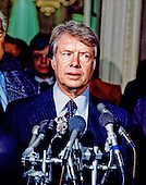 United States President-elect Jimmy Carter meets reporters after meeting with Congressional leaders in the US Capitol in Washington, DC on November 23, 1976.<br /> Credit: Barry A. Soorenko / CNP